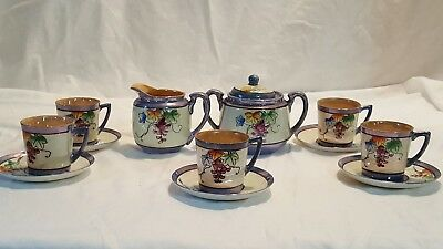 Small child's  tea set hand painted in japan No teapot.  Very cute! Grapes de