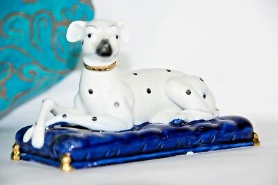Porcelain White Dalmatian Dog Figurine Golden Color laying on Royal Blue Pillow