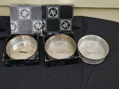 Strachan Silver plated bottle holders in very good condition.