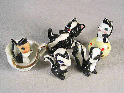 5 Assorted old & unusual Skunk Bone China and Ceramic Figurines