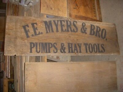 """antique myers pumps/ antique hay trolley/ old 17"""" by 54"""" wood sign"""
