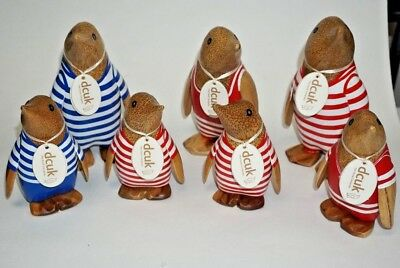 Set of seven (7) - DCUK Hand Painted Penguins (3 Medium, 4 small)