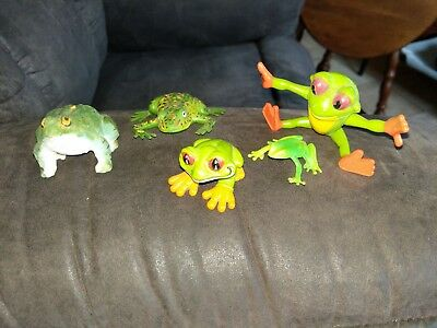 Five total frogs fiqures. One wood & Four plastic ones.