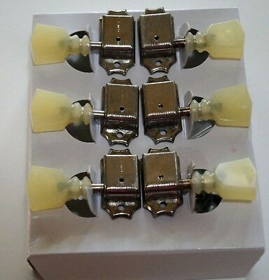 Aged Authentic Kluson nickel 3 on a side tuners, double loop plastic buttons