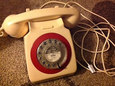 Vintage GPO dial telephone, ivory/cream red bezel and original paper disc.