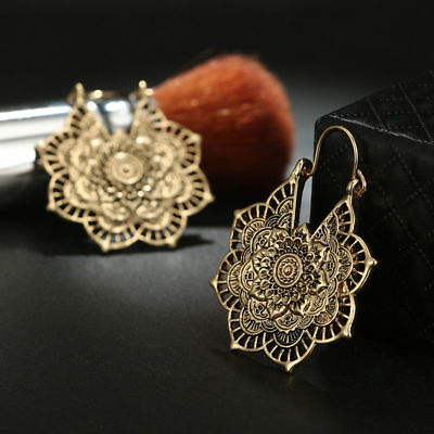 Ancient silver gypsy Indian tribe mandala rings hang in ethnic Bohemian earrings