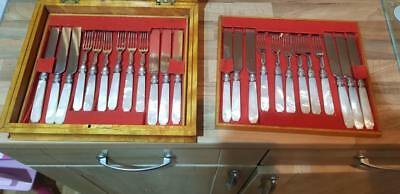 a beautiful antique 24 piece cutlery set with mother of pearl handles.elegant.