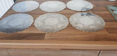 a set 6 of vintage silver plated table coasters with elegant engraved patterns.