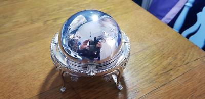 a beautiful antique silver plated butter dish with hand engraved patterns.ornate