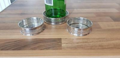 a set of 3 vintage silver plated wine coasters,1 for a bottle and 2 for glasses.