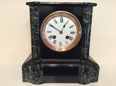 A delightful French Black Slate and Marble Mantel Clock c1870s