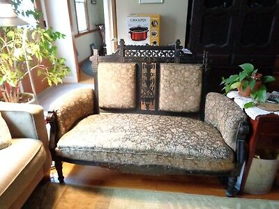 Eastlake settee, walnut stain, needs re-upholstering