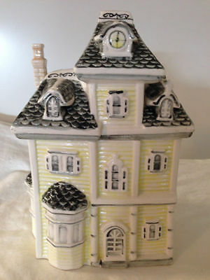 """VICTORIAN HOUSE~Ceramic Cookie Jar Light Yellow With Black Roof Raised 10"""" tall."""