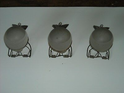 "3 ""Grenade"" style glass bulb fire extinguishers w/ wire hangers."