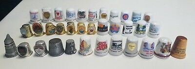 Travel thimble collection of 35 thimbles