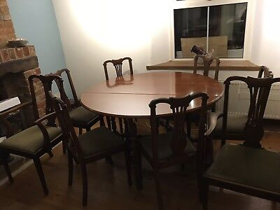 Large mahogany dining table expanding with 8 chairs green seats vintage 1950s