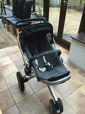 Quinny Buzz Black stroller with interchangeable car seat, plus extras.