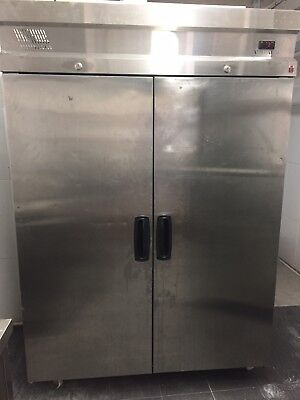 2 Door Stainless Steel Fridge 1400 Lt Good Condition On Caster Wheels. No Glass