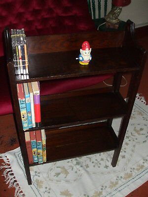 Antique Arts and Crafts oak lattice sided bookcase, with small heart