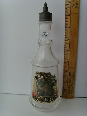 "Antique Label Under Glass ""TONIC–H.W. Zeitzinger"" Barber Bottle 9"" 41/38"