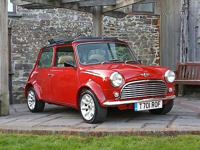 Classic Mini Cooper Sport With Full Cream Leather Searts and An Electric Sunroof