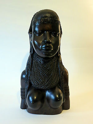 African hand carving of a female bust signed by Ngomo