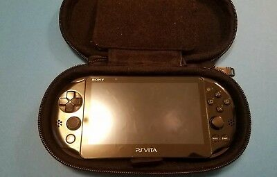 Sony PlayStation Ps Vita. Memory card, charger, silicone cover, carrying case