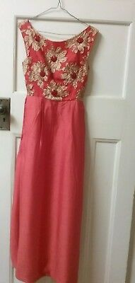 Gorgeous 1960s floor length gown.Coral red colour.Size 6.