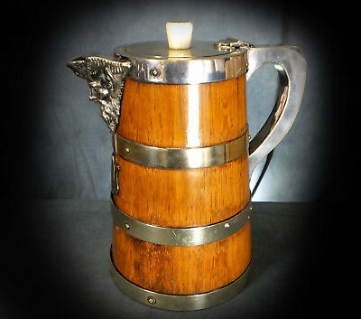SUPERB LARGE 19th. CENTURY SILVER PLATE ON OAK ALE JUG