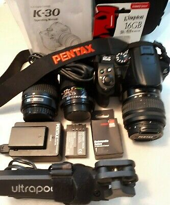 Pentax K 30 Camera charger, 3 batteries.18-55mm,50-200mm,135mm lenses.usb cable