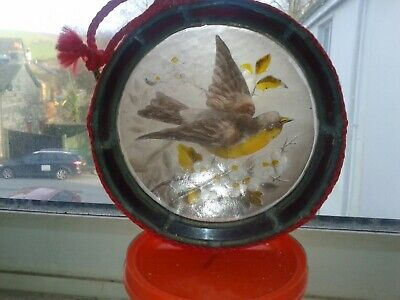 antique painting, bird on stained glass leaded window