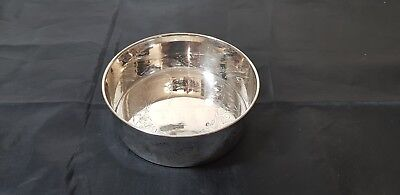 A Very Elegant Vintage Silver Plated Wine Bottle Coaster with engraved patterns.
