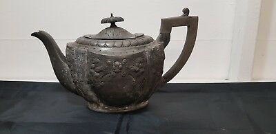 An Antique 1890.s Silver Plated Tea Pot With Embossed Patterns.very collectable.