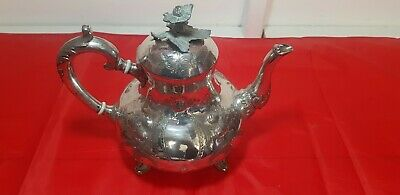 A beautiful antique 1890.s victorian silver plated embossed tea pot.