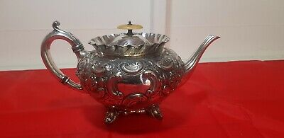 An Antique victorian Silver Plated Embossed Tea Pot By Atkin Brothers.sheffield.