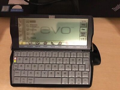 Vintage Retro Psion Revo Pocket PDA Computer wIth Charging Base and Leather Case
