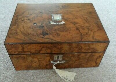 Victorian Burr Walnut box with lovely mother of p. decoration and a locking key.