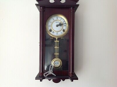 highland wall clock antique wood wind up good condition 19x7 depth 4inches