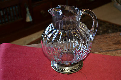 Beautiful crystal jug with silver base