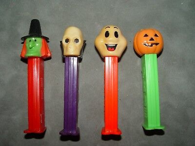 4 Pez Dispensers halloween witch ghost skull pumpkin
