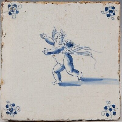 Nice Dutch Delft Blue tile, angel with mask, second half 17th. century.