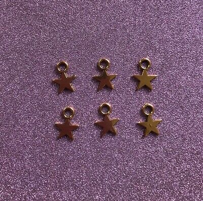 6 Small Antique Goldtone Star Charms