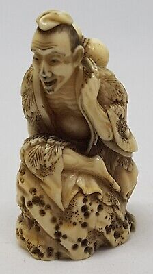 EXQUISITE ANTIQUE JAPANESE NETSUKE 19th CENTURY BOVINE CARVING OF A MAN ON ROCK