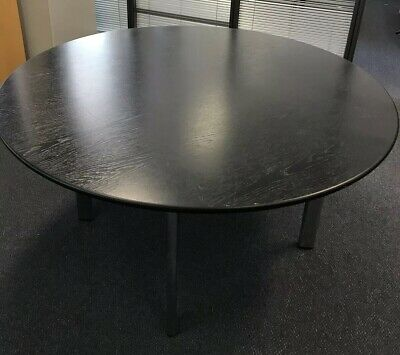 black round timber Office meeting table with chrome legs 0.73m H × 1.37m W