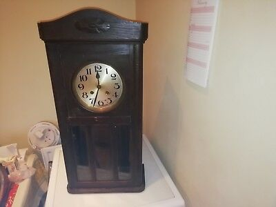 An Edwardian Oak Wall Clock