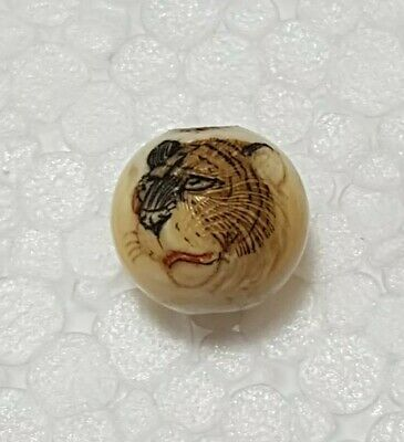 A Lovely Meiji Period Ojime etched with a Sumi ink Tiger.