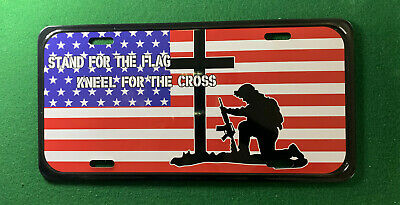 Stand for the flag kneel for the cross Front License Plate, Vanity Tag