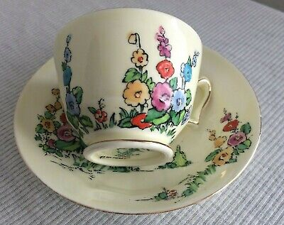 Vintage Crown Staffordshire Hollyhocks Tea Cup And Saucer