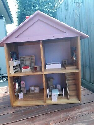 large wooden dolls house with cute wooden furniture