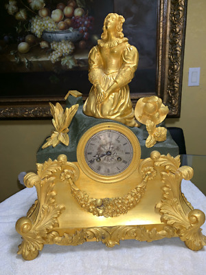 """Gilt French Bronze Clock from 1800 with a kneeling lady, movement signed """"Pons"""""""